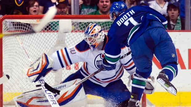 With an intraconference-only schedule likely, the shortened NHL season should be heavy on divisional rivalry games like Canucks-Oilers. (Rich Lam/Getty Images)