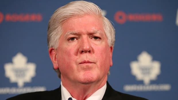 In their debut Punjabi podcast, commentators Harnarayan Singh and Bhola S. Chauhan address the Brian Burke firing. (Chris Young/Canadian Press)