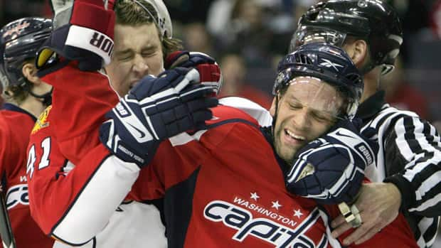 Twenty-year pro Bryan Helmer, right, got a rare NHL shot with Washington in the 2008-09 season. (Lawrence Jackson/Associated Press)