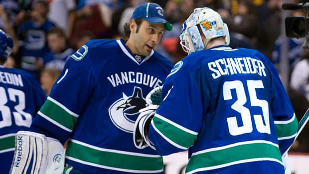 Roberto Luongo, left, and Cory Schneider are sharing time in the Vancouver crease, for now. (Rich Lam/Getty Images)