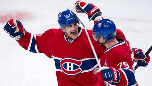 Montreal Canadiens defenceman Andrei Markov (79) celebrates his first of two goals with teammate Max Pacioretty, left, Tuesday night against the Florida Panthers. (Paul Chiasson/Canadian Press)
