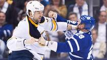 Leafs forward Colton Orr, right, got the better of a fight with Buffalo Sabres giant John Scott, left, Monday night at the Air Canada Centre. (Nathan Denette/Canadian Press)