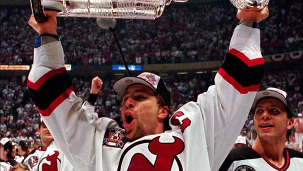 New Jersey Devils captain Scott Stevens holds up the Stanley Cup after his team defeated the Detroit Red Wings in four games to win the Stanley Cup in June 24, 1995.  (AP Photo/Bill Kostroun)
