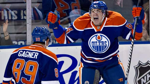 Edmonton Oilers' Nail Yakupov, right, celebrates his first NHL goal with teammate Sam Gagner against the San Jose Sharks in Edmonton, Alta., on Tuesday January 22, 2013. (The Canadian Press/Jason Franson)