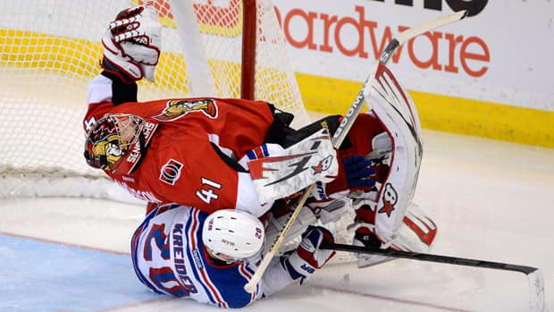 Ottawa Senators goalie Craig Anderson tumbles over as Rangers forward Chris Kreider slides into him on Thursday night. (Adrian Wyld/Canadian Press)