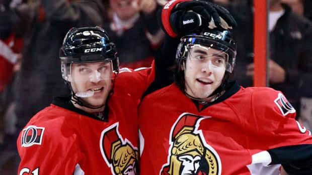 Ottawa Senators' Andre Benoit , left, celebrates teammate Mika Zibanejad's goal against Montreal in January. Benoit beat the odds, becoming a 29-year-old NHL rookie. (Blair Gable/Reuters)
