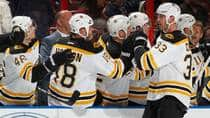 Boston Bruins defenceman Zdeno Chara is congratulated by teammates after scoring a first-period goal against the Florida Panthers at the BB&T Center on Sunday in Sunrise, Fla. (Joel Auerbach/Getty Images)