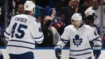 Toronto Maple Leafs forward Nazem Kadri, right, celebrates one of his three goals on Thursday against the New York Islanders along with Mark Fraser at the Nassau Veterans Memorial Coliseum in Uniondale, New York. (Bruce Bennett/Getty Images)