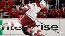This hit by the Coyotes' Raffi Torres (front) on Chicago's Marian Hossa ended both of their seasons in 2012. (File/Associated Press)