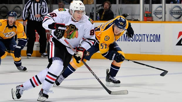 Patrick Kane (88) of the Blackhawks eludes Gabriel Bourque in Sunday's 3-0 win over the Predators at Bridgestone Arena. (Frederick Breedon/Getty Images)