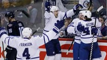 Tyler Bozak (42), Cody Franson (4) and James van Riemsdyk (21) celebrate Phil Kessel's (81) first goal of the season Thursday against the Winnipeg Jets. (John Woods/Canadian Press)
