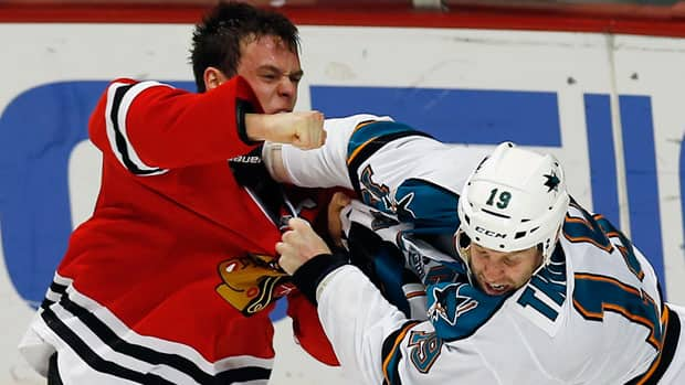 Chicago Blackhawks' Jonathan Toews, left, throws a punch at San Jose Sharks' Joe Thornton during a fight in the first period Friday. (Jim Young/Reuters)