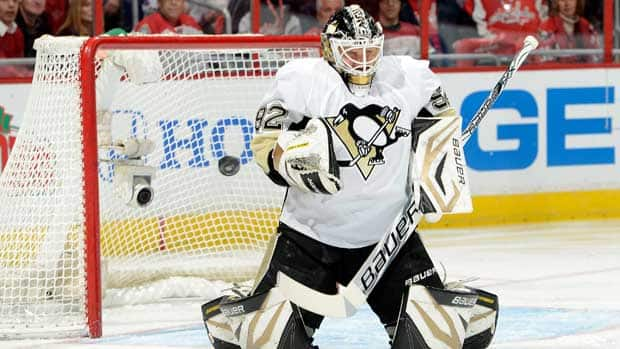 Pittsburgh Penguins goalie Tomas Vokoun made 21 saves on Sunday against the Washington Capitals, but he likely wishes he could have one back against John Carlson. (Greg Fiume/Getty Images)