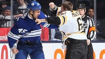 Leafs defenceman Mark Fraser, left, exchanged blows with Bruins winger Lane MacDermid, right, twice on Saturday night. (Frank Gunn/Canadian Press)