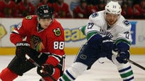 The NHL's new proposal could increase the chances of a Blackhawks-Canucks playoff matchup. (Jonathan Daniel/Getty Images)