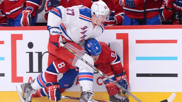 New York Rangers defenceman Ryan McDonagh, front, left Saturday night's game against the Montreal Canadiens after getting drilled into the boards by Habs forward Max Pacioretty, not pictured. (Richard Wolowicz/Getty Images)