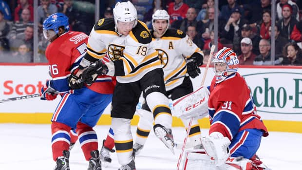 Despite being shaken up in warmups, Canadiens goalie Carey Price, right, did start against the Boston Bruins on Wednesday night at the Bell Centre. (Richard Wolowicz/Getty Images)