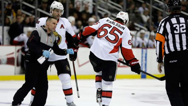 Ottawa Senators' Erik Karlsson limps off the ice after suffering a laceration on his Achilles' tendon on Wednesday, Feb. 13, 2013. (Gene J. Puskar/AP Photo/)