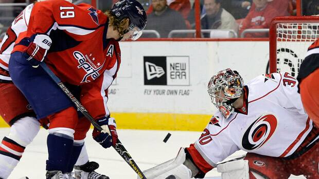 Carolina Hurricanes goalie Cam Ward (30) made the save of the night against the Washington Capitals Tuesday. (Alex Brandon/Associated Press)