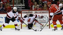 New Jersey Devils goalie Martin Brodeur, centre, got his name on the scoresheet against the Carolina Hurricanes on Thursday night in Raleigh, N.C. (Gerry Broome/Associated Press)