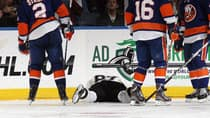 Sidney Crosby (87), shown in this file photo after being struck in the face by a puck, must be getting tired of playing the Islanders since it seems that type of injury keeps happening to him in those games. (File/Getty IMages)