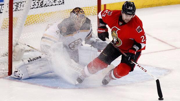 Ottawa Senators winger Kaspars Daugavins, right, takes a shot on Boston Bruins goalie Tuukka Rask during the shootout Monday. (Chris Wattie/Reuters)