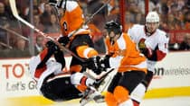 The Philadelphia Flyers' Harry Zolnierczyk was suspended four games for this hit on Ottawa's  Mike Lundin. (Michael Perez/Associated Press)