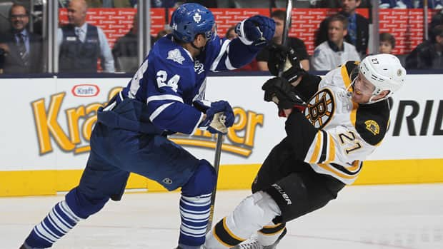 Toronto Maple Leafs defenceman John-Michael Liles, left, nails Dougie Hamilton of the Boston Bruins at the Air Canada Centre in Toronto Saturday. (Claus Andersen/Getty Images)