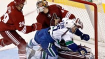 Vancouver Canucks' Daniel Sedin (22) collides with Phoenix Coyotes' goalie Mike Smith (41) during the second period Friday. (Ross D. Franklin/Associated Press)
