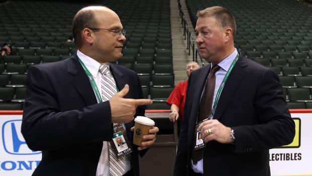 Boston's Peter Chiarelli, left, and Vancouver's Mike Gillis are among the NHL GMs who could be looking to pull the trigger on a deal to bolster their rosters. (Bruce Bennett/Getty Images)