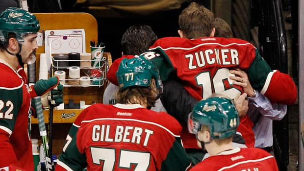Minnesota Wild left wing Jason Zucker (16) is helped off the ice after suffering an injury during the second period against the Anaheim Ducks Tuesday night. (Genevieve Ross/Associated Press)