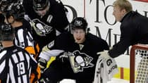 Pittsburgh Penguins winger James Neal is helped from the ice by Evgeni Malkin (71) and a trainer during the third period after he took an elbow from Rangers defender Michael Del Zotto Friday night. (Gene J. Puskar/Associated Press)