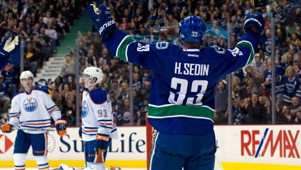It hasn't always been pretty, but Henrik Sedin (33) and the Canucks have had plenty of new  reasons to celebrate this season. (Rich Lam/Getty Images)