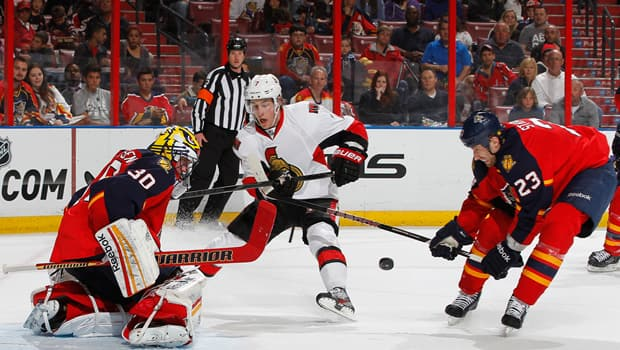Kyle Turris (7) of the Senators is foiled by netminder Scott Clemmensen in Sunday's 2-1 loss to the Panthers in Sunrise, Fla. (Joel Auerbach/Getty Images)