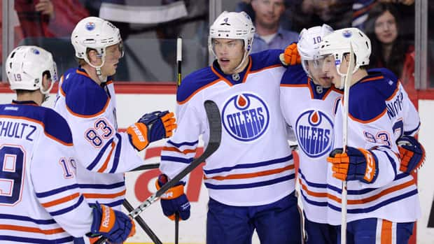Taylor Hall, centre, celebrates an Edmonton goal during an April 3 game with a mix of Oilers veterans and young players. It will now be up to Craig MacTavish to decide the core group the team will build around. (Larry MacDougal/Canadian Press)