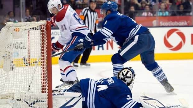 Montreal Canadiens centre Lars Eller (81) scores on Toronto Maple Leafs goaltender James Reimer, bottom, as defenceman Cody Franson (right) tries to defend during first period Saturday night at Air Canada Centre. (Frank Gunn/Canadian Press)