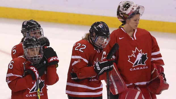 Team Canada captain Hayley Wickenheiser (22) and the rest of her teammates face many questions leading into the 2014 Sochi Olympics. (Fred Chartrand/Canadian Press)