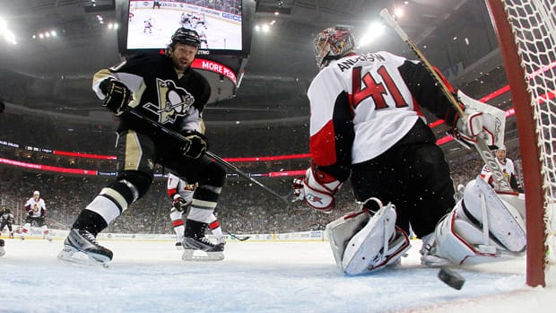 Pittsburgh Penguins forward Brenden Morrow scores in the first period on goalie Craig Anderson in Game 5 at Consol Energy Center on Friday in Pittsburgh, Penn. (Justin K. Aller/Getty Images)