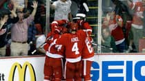 Detroit Red Wings players celebrate centre Gustav Nyquist's goal against the Chicago Blackhawks during the second period in Detroit on Monday. (Paul Sancya/Associated Press)