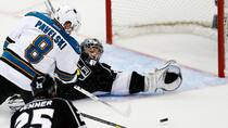 Los Angeles Kings goalie Jonathan Quick, rear right, makes a save on San Jose Sharks centre Joe Pavelski, left, in the third period of Game 7. (Lucy Nicholson/Reuters)