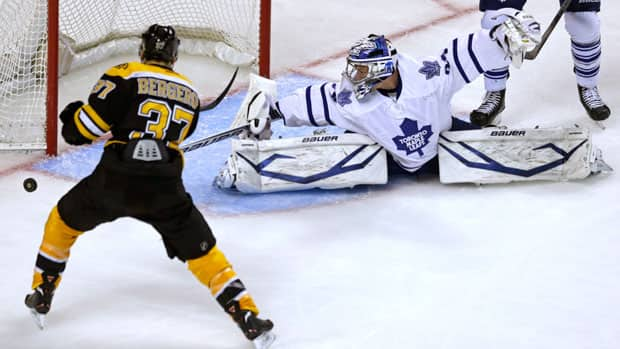 Toronto Maple Leafs goalie James Reimer, right, spreads the pads to make a save on Boston Bruins centre Patrice Bergeron during the second period in Game 5 in Boston on Friday (Charles Krupa/Associated Press)
