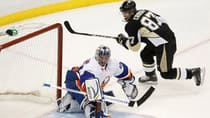 Pittsburgh Penguins' Sidney Crosby, right, scores on New York Islanders goaltender Evgeni Nabokov during the second period of Game 5 in Pittsburgh, Penn., Thursday. (Jason Cohn/Reuters)