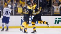 Patrice Bergeron (37) celebrates his Game 7 overtime goal against the Toronto Maple Leafs Monday night with teammate Zdeno Chara. (Jared Wickerham/Getty Images)