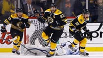 Patrice Bergeron (37) exults in scoring the overtime winner as the Bruins rally to beat the Leafs 5-4 in Game 7 on Monday. (Jared Wickerham/Getty Images)
