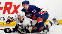 Islanders forward Casey Cizikas (53) checks defenceman Brooks Orpik in a 6-4 victory over the Penguins on Tuesday night. (Bruce Bennett/Getty Images)