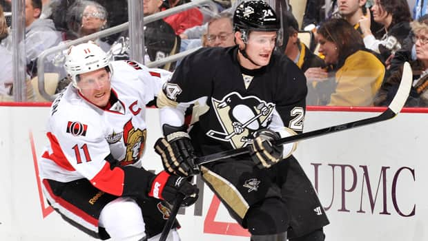 Daniel Alfredsson (11) and the Senators will need to hold Matt Cooke and the Penguins in check. (Jamie Sabau/Getty Images)