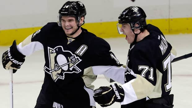 Penguins forwards Chris Kunitz, left, and Evgeni Malkin have been part of a power-play unit that's scoring on a 36 per cent clip this post-season. (Gene J. Puskar/Associated Press)