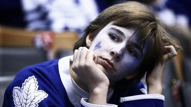 A Maple Leafs fan reacts with disappointment after Toronto lost 5-2 to the Boston Bruins in Game 3 Monday night. (Mark Blinch/Reuters)