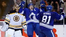Maple Leafs captain Dion Phaneuf, middle, whoops it up upon opening the scoring in a 2-1 victory over the Bruins on Sunday. (Mark Blinch/Reuters)