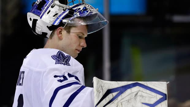 Although Toronto Maple Leafs goalie James Reimer was shaky against the Boston Bruins, he was also hung out to dry by his teammates. (Elise Amendola/Associated Press)